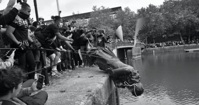 The statue of slave trader Edward Colston getting toppled into the water by Black Lives Matter protestors in Bristol in the aftermath of the murder of George Floyd in June 2020.